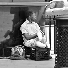 Legless Man - Chicago, IL (homiga) Tags: portrait people blackandwhite chicago man photo illinois streetlife beggar amputee chicagoillinois legless
