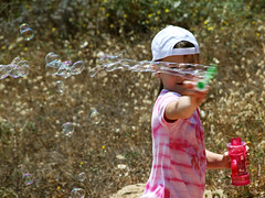 Bubbling youth (Gaby.Bernstein) Tags: portrait girl face hat toy kid bottle gaby bernstein soapbubbles bernsteingaby gabybernstein