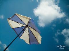umbrella (Mozamel) Tags: blue summer sky white abstract beach alexandria weather clouds canon ixus umbrealla