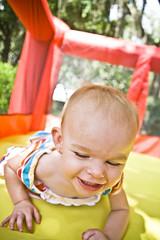 Fall Down Smiles (crashmattb) Tags: tampa outside kid jump afternoon play florida may odessa inflatable playpen 2010 jumperoo canoneosdigitalrebelxti sigma1770mmf2845dc photoshopcs3
