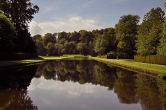 Fountains Abbey Gardens (SinadWeyer) Tags: old trees summer sky plants lake reflection tourism water beautiful gardens landscape scenery pretty view perspective ruin sunny medieval watergarden greenery fountainsabbey northeast atmospheric northyorkshire dayout ripon 1500s