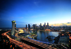 Singapore Skyline (` Toshio ') Tags: city blue sunset storm architecture clouds buildings singapore asia downtown cityscape cloudy casino cbd hdr highdynamicrange centralbusinessdistrict toshio singaporeflyer marinasands cmwdblue cmwdweeklywinner