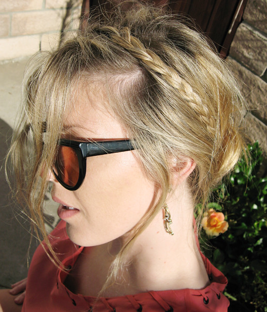 braids in hair and cat eye sunglasses-og