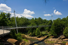 Liberty Bridge @ Falls Park (JayCaps) Tags: bridge sky canon river landscape downtown jay 1855mm greenville fallspark reedyriver greenvillesc libertybridge suspendedbridge capilo t2i jaycaps
