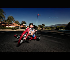 Speed Racer (isayx3) Tags: street portrait nikon child angle wide studios alienbee bigwheel f28 d3 onelight sigmas dirtysensor 14mm pocketwizards beautydish strobist vagabound b1600 plainjoe zarias isayx3 hobd