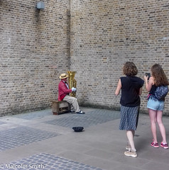 The Audience (M C Smith) Tags: music instrument hat stripes wall pavement girls phonecamera walls light red gold