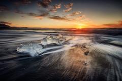 Diamond beach II, Iceland (Luis Cagiao) Tags: iceland islandia diamond beach jokulsarlon glacier lagoon ice sea ocean sky sunrise clouds wave