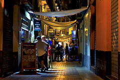 Summer night (Daniel Nebreda Lucea) Tags: people night noche gente city ciudad urban urbana color colores lighs luces shadows sombras life vida zaragoza europe europa weekend holidays vacaciones happy feliz canon 50mm 60d long exposure larga exposicion architecture arquitectura building edificio street calle scene escena bares bar pubs enjoy divertirse lights