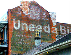 UNEEDA BISCUIT... (photogtom43) Tags: signs louisiana neworleans sanyo bourbonstreet uneedabiscuit oldsigns nabisco paintedsigns nationalbiscuitcompany sanyodigital