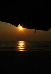 SunStar (Midhun Manmadhan) Tags: sunset beach star goa anjuna canonpowershots3is ubmrella