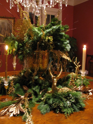 GREENS AND GOLDS ,DEER, CANDLES MAKE A WONDERFUL CENTERPIECE