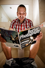 Yeah!  I got a 2 page spread :-) (r c hill photography) Tags: portrait man magazine reading toilet jeans ankles strobist