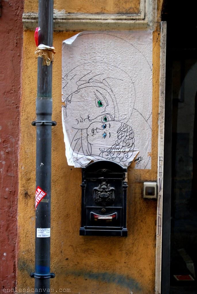 Street Art Wheatpaste in Monti, Rome, Italy.
