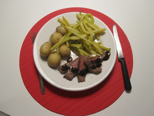 Steak with HP sauce, potatoes, beans