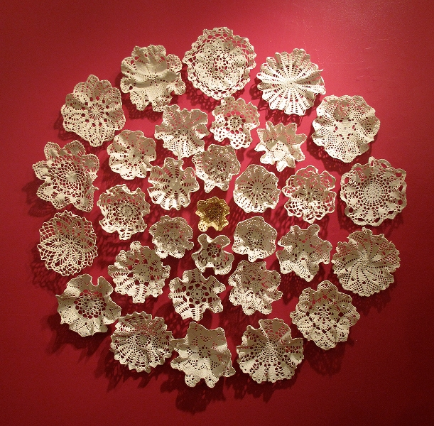 Crocheted cotton lace doilies wall piece by designer Kristen Wicklund