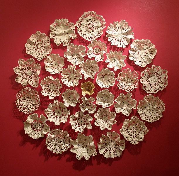 Crocheted cotton lace doilies wall piece by designer Kristen Wicklund