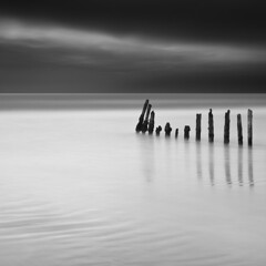 IIIiiiiIIIII (maxxsmart) Tags: ocean sanfrancisco california longexposure winter sky bw seascape weather clouds canon pier blackwhite sticks pacific january highcontrast lee bayarea fortfunston 1x1 2010 gnd ef2470f28l ndgrad nd110 10stopnd 5dmarkii