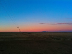 (davidteter) Tags: road newmexico powerlines dirt stanley poles prairie stream:timeline=linear appleiphone3gs