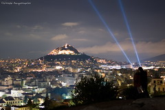 Close Encounters (Christophe_A) Tags: city longexposure light rock night nikon couple cityscape nightlights cloudy athens beam greece citylights nightview christophe cinematic closeencounters lycabetus akropoli topseven ελλαδα ακροπολη βραχοσ christopheanagnostopoulos χριστοφοροσαναγνωστοπουλοσ χριστόφοροσαναγνωστόπουλοσ
