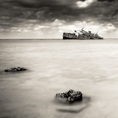 True Story (Khaled A.K) Tags: longexposure sea blackandwhite bw monochrome rock clouds mono rocks shipwreck sa jeddah wreck saudiarabia khaled ksa saudia jiddah kashkari