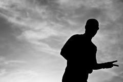the silhouette (Socceraholic) Tags: white david black blanco monochrome silhouette digital canon rebel 50mm al shadows y negro kuwait f18 hamad imbored guetta xti 400d ajmi