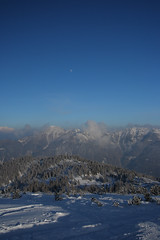 the power of silence ((:Andrzej:)) Tags: blue trees sky moon snow mountains alps clouds austria alpen gry alpy nieg ksiyc naturesfinest chmury supershot kleinarl abigfave platinumphoto anawesomeshot yourwonderland drzewaniebo