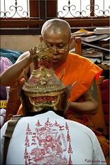 Blowing Blessings (Ursula in Aus) Tags: tattoo thailand yantra tattooing waikhru nakhonpathom นครปฐม ประเทศไทย sakyant tattoofestival รอยสัก watbangphra nakhonchaisi earthasia nakhonchaisri วัดหลวงพ่อเปิ่น ครู รูปสัก วัดบางพระ ลายสัก สักยันต