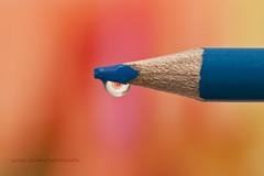 Just another waterdrop (George Goodnight) Tags: blue red orange blur macro water yellow nikon waterdrop bokeh refraction crayon coloredpencil melissaetheridge 105mmf28 nikond300 bringmesomewater georgegoodnightphotography