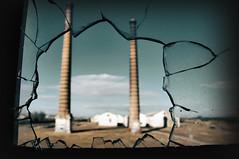 Cracks in the windows, open wounds ... (RominikaH) Tags: abandoned window ventana factory zaragoza destroyer decayed fabrica destroy rota abandonado grietas 18200mm epila craks enfoquemanual fzfave rominikah retofez100406