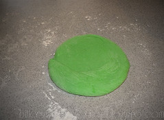 st patricks day pizza green dough rolling out