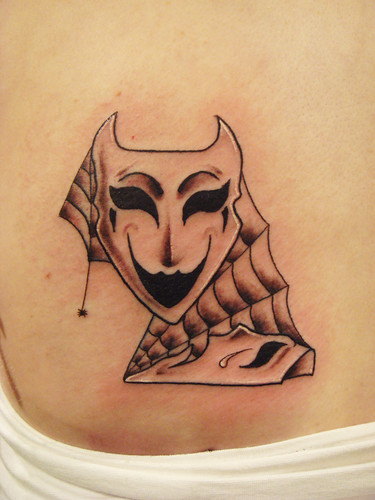 Theatre mask tattoo (designed by Natalia Radziwillowicz)