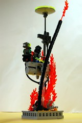 Robot Battle Above Burning Lava Pit (unhh) Tags: lava robot lego flames battle swords