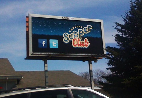 capital supper club billboard with facebook and twitter icons on it