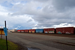 Clouds On The Move (everkamp) Tags: seattle railroad sky clouds graffiti washington trains freight boxcars trainyard rollingstock railart benching