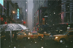 (petrichw) Tags: new york city winter snow yellow umbrella square lights taxis busy around times avenue 5th 47 artlibres taltotw