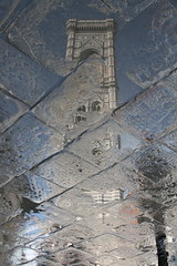 Reflection of Campanile di Giotto (designsbykari) Tags: italy reflection rain canon puddle florence italia firenze piazzaduomo giottostower