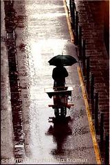 Tarde de lluvia (Natalia Kramer) Tags: barcelona rain lluvia bcn bici paraguas pluja