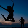 sisters (Will Montague) Tags: blue sunset orange beach rivalry gulfofmexico silhouette sisters dark happy dance jump nikon florida dusk joy happiness siblings mad limelight steal montague disapproval exuberance annoyance gulfcoast irritation annoy exultation rival d90 jubilance silhouettesshadows platinumphoto willmontague