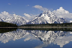 Reflections at Jackson Lake (bhophotos) Tags: travel usa lake mountains reflection nature water landscape geotagged nikon day wyoming tetons grandtetonnationalpark jacksonlake mtmoran d700 2470mmf28g mtwoodring projectweather bruceoakley pwpartlycloudy