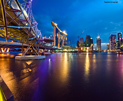 The Marina Sands Resort :: The Helix :: Singapore (Ragstatic) Tags: city light money color reflection water metal skyline marina buildings river nikon singapore cityscape view rags central casino resort cbd helix sands dri inauguration singaporeriver nocture singaporecity marinabaysands d700 marinasands bluhour