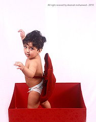 Big Gift =p [explored] (Deemah Al-Shaaya - twitter.com/#!/deemah_sh) Tags: camera red white smile kids canon children photo kid child box pic gift   nayef        deemah   nayf    doeem