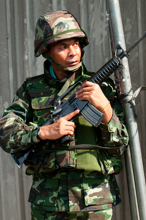 Government soldier looks for snipers, Rama IV, Bangkok