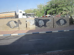 a very famous jew (conskeptical) Tags: road trees sky outdoors graffiti israel einstein vegetation kerb markings