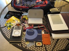 Day to day stuff. (Poodlerockin) Tags: arizona sunglasses glasses ipod thenorthface ds knife books cigar ups videogames backpack pens matches notebooks coughdrops nintendopower kindle macbook dslite