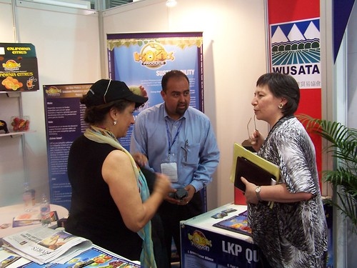 FAS Associate Administrator Janet Nuzum speaks with U.S. exporters at the Western United States Agricultural Trade Association booth in the USA Pavilion at the SIAL China 2010 Trade Show in Shanghai, China. Photo Credit: Bill Shen, U.S. Agricultural Trade Office, Shanghai, China