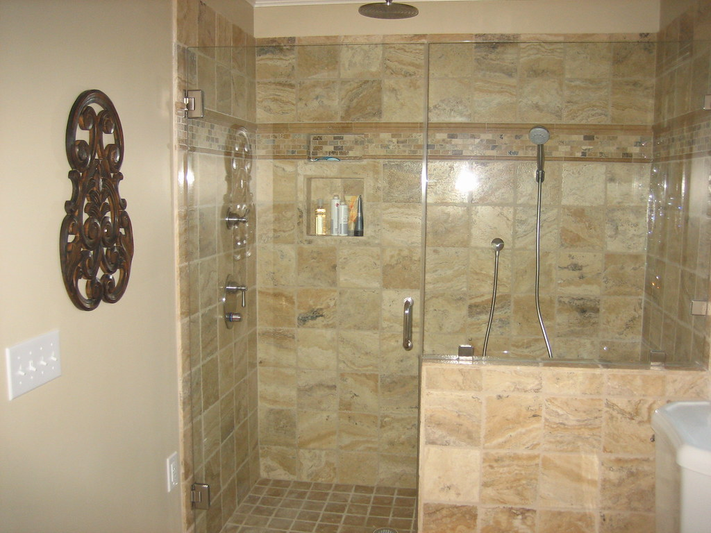 Large glass enclosed shower with rain shower head
