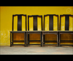 Equal Opportunity (Yug_and_her) Tags: china texture yellow wall temple wooden interiors order chairs buddhist chinese newyear line macau seating arranged equal