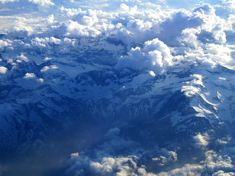 swiss alps and clouds