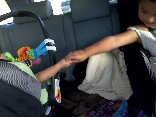 holding hands in car for first time.