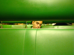 (boscoboscobosco) Tags: sleeping man green netherlands amsterdam horizontal train europe space seat young gap center line inside through traveling hiding greenseat spacebetween